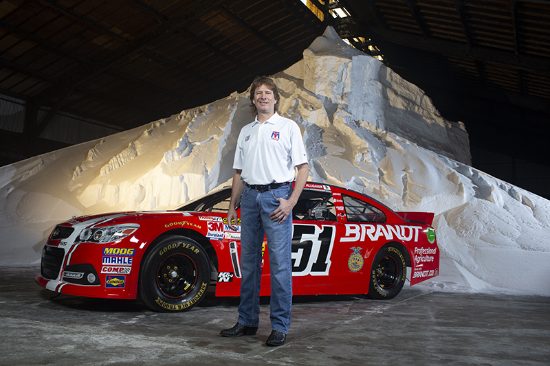 Rick Brandt with Racecar in Plant Building